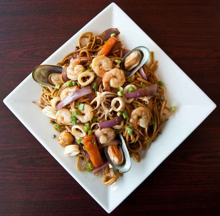 Tallarin Saltado with Calamari and Mussels.